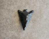 large obsidian arrow head (1 piece)