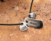 """Love, Dream, Laugh charm necklace on black 18"""" Lobster Clasp Rubber Cord"""