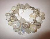 Beaded Bracelet with Crystal and Irridescent Czech Glass, Shell Beads, Mother of Pearl and Tibetan Silver Charms