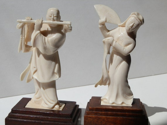 Elephant Ivory figures. Two Vintage Pre Ban Vietnamese carved real Ivory pieces on stands. Signed Tu-Van.