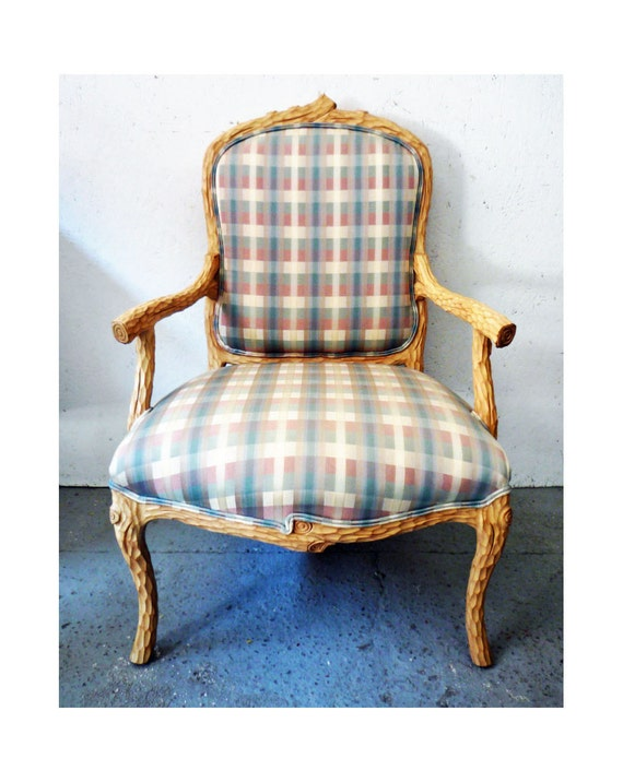 vintage fauteuil arm chair with a carved twig frame plaid