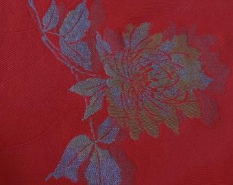 Metallic gold and silver roses on orange-red kimono silk.