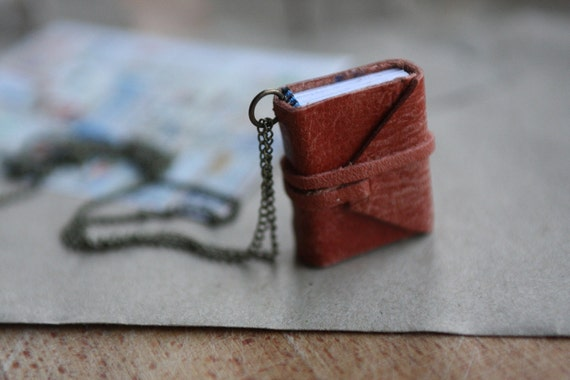 The New Poetry Handbook by Mark Strand. Mini book necklace with poem.