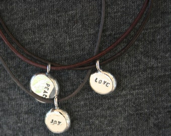 Leather word bracelet/necklace