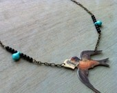 Sparrow Necklace with Black and Turquoise Beads.