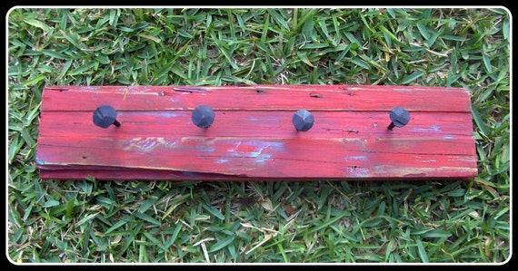 Hand Forged Nails on Rustic, Reclaimed Wood in Barn Red