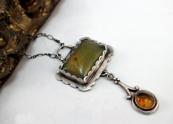 Silver Serpentine Pendant With Vintage Amber Drop