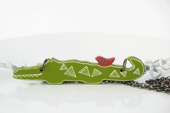 Unusual Friendship Green Crocodile with Red Bird