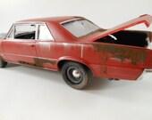 1964 pontiac GTO 1/24 scale model car in red