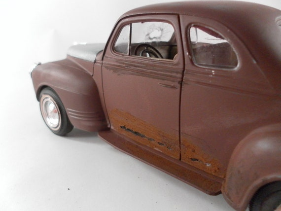 1941 Plymouth 1/24 scale model sedan in brown