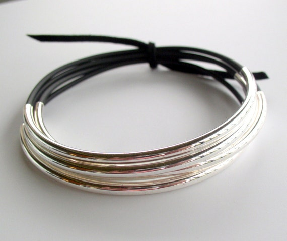 Large wrist sized black and silver stacking bracelets
