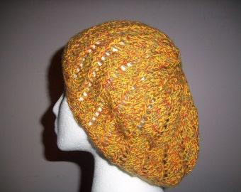 Hand made knit hat in yellow, rust and green with detachable pompom in light weight cotton and acrylic.