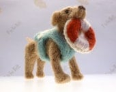 Needle felted dog wearing lifeguard vest and holding life preserver ring in mouth