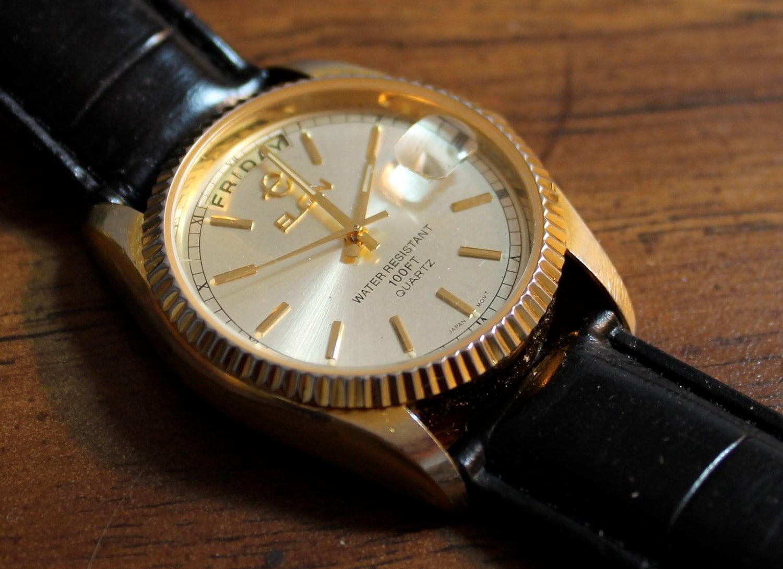 vintage elgin gold tone quartz
