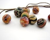 Multi-colored Wooden Beads .... look like marbles to me, Bob