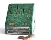 Vintage Perpetual Calendar Advertising Coin Bank Green