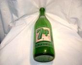 Large Green glass 7-UP beverage bottle