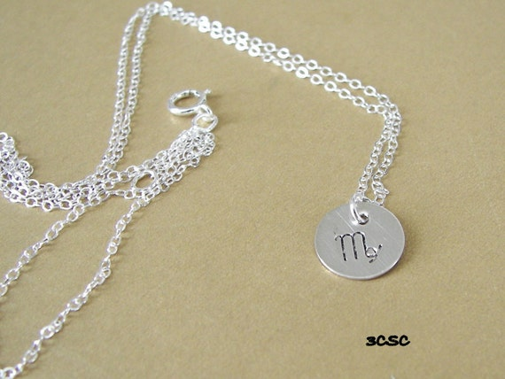 Sterling silver necklace with small Zodiac symbol