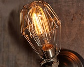Industrial wall sconce with vintage style light bulb cage