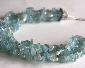 Necklace made with Aquamarine glass chips, freshwater pearls, Swarovski crystals and sterling silver