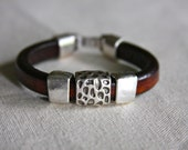 Brown leather bracelet with pewter animal print slide bead and clasp