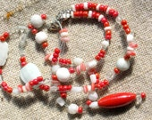 Lightweight salmon orange and white triple strand beaded necklace with fish pendant