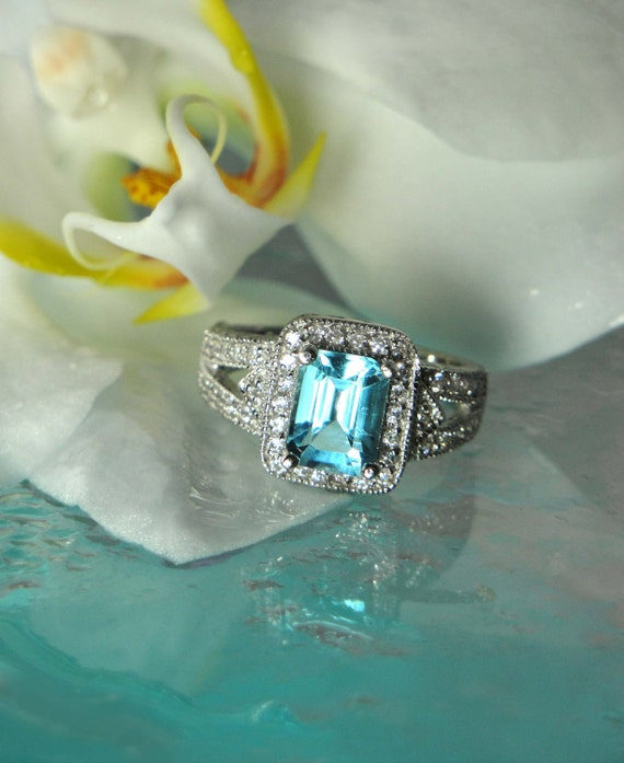 Stunning Emerald Cut Blue Topaz And White Topaz Princess Style Ring