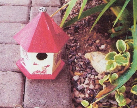 Decorated wooden birdhouse,  red pagoda with button and tassel,