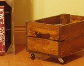 Wooden apple crates with castors for general storage, or as planters in the garden for flowers