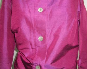 Hot fuchsia hand-tailored shantung silk blouse.  Long sleeved with cuffs.