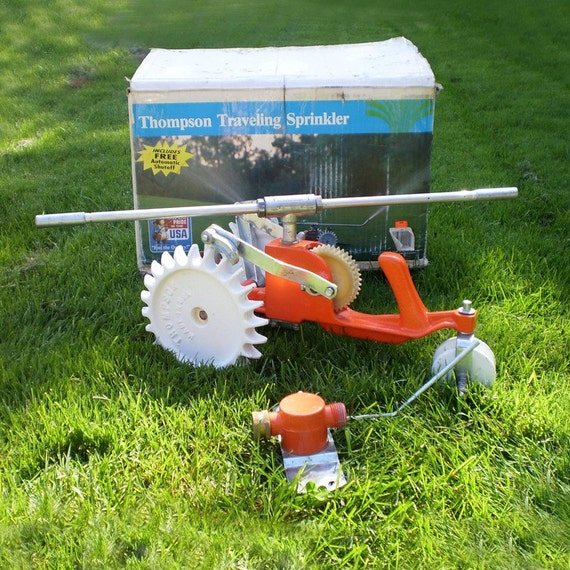 Traveling Lawn Sprinkler Tractor : Vintage thompson tractor sprinkler with shut off free usa