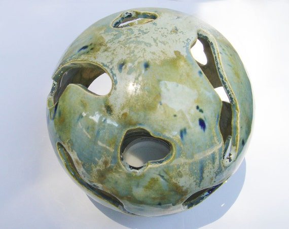 ceramic candle lamp with decorative holes