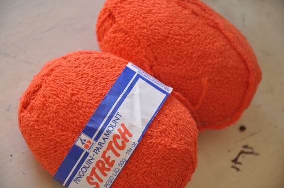 Two balls bright orange stretch yarn by Pingouin-Paramount
