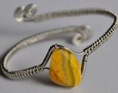 Wire wrapped bracelet, yellow stone bead, adjustable bangle bracelet