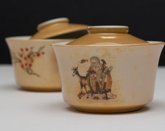 A pair of covered ceramic bowl and spoons