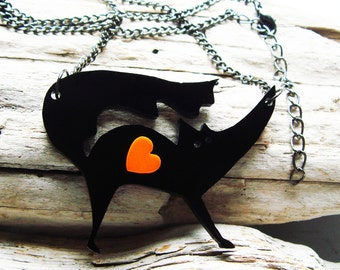 Elsie the Black Fox laser cut acrylic necklace with an orange heart