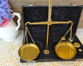 Vintage Apothecary Jewelry Gold Balance Scales with weights in a travel box