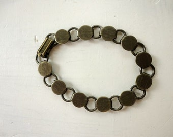 1 Antique Brass Plated Disk and Loop Bracelet with Glueable Pads