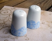 White ceramic salt and pepper shakers with hand-painted light blue henna designs - India inspired
