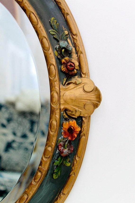 Vintage ornate frame with a beveled mirror