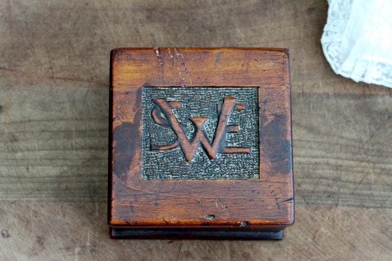 Vintage wooden box with wood carved initials