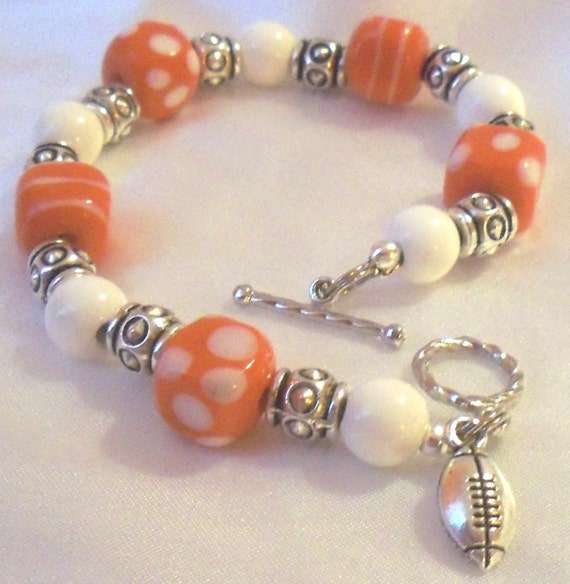 Bracelet, Orange and White, Football Charms, Lampwork Beads made by Lavender Daisy on Etsy