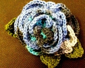 Blue & gray crochet rose pin to raise money for Cystic Fibrosis research