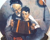 The Music Maker by Norman Rockwell.  Fifth in the Rockwell Heritage Collection