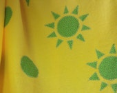 yellow baby blanket with green stars