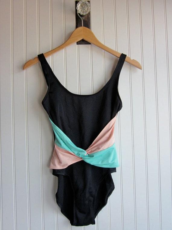 1980s bathing suit, black and pastel. Vintage one piece retro 80s aqua & pink tank style.