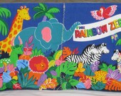 """Soft Cloth Book """" The Rainbow Zebra"""" One Special """" Rainbow Zebra"""" with bright colorful stripes of Rainbow in yellow, green, red and Blue."""