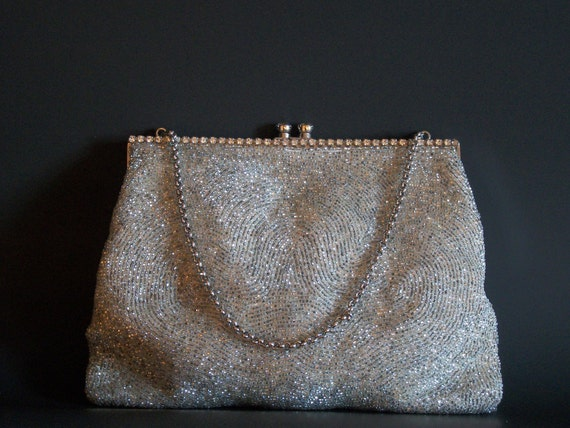 Hand beaded silver clutch with rhinestone clasp by Magid.