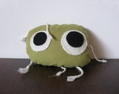 Funky green pillow softie. Original, collectible and fun, and answers to RANDAL JOUBERT.