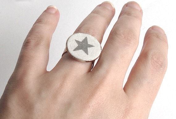 Fabric ring in grey and white on an adjustable silver tone ring base.